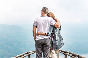 Happy young couple of tourists on