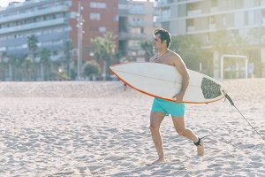 Beach water sports surfing man with