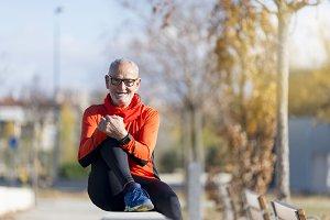 Senior runner man sitting after jogg