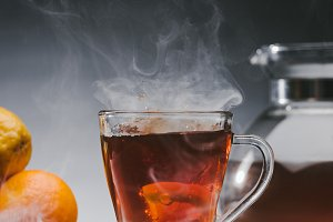 Steaming cup of spicy black tea with