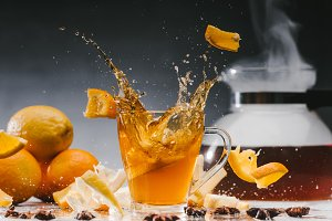 Large splashes of tea in glass cup w