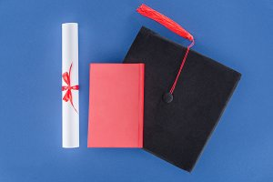 Education concept with diploma and g
