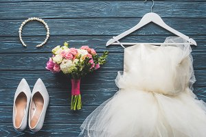 top view of wedding bouquet and dres