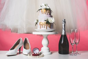 pair of shoes, wedding cake and cham