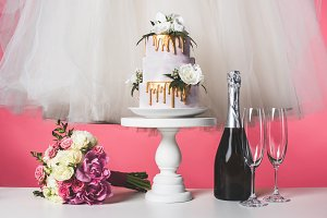 wedding bouquet, cake and white dres