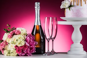 wedding bouquet, champagne and cake