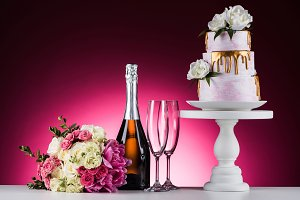 wedding bouquet, champagne with glas