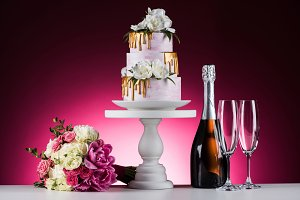 wedding bouquet, cake and champagne