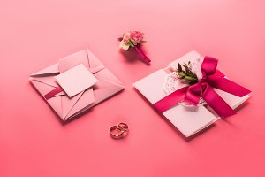 wedding rings, boutonniere and pink