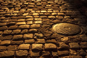 cobblestone and sewer hatch