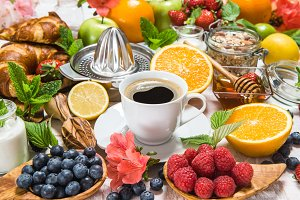 Coffee, croissants, granola, fruits