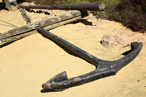 Old anchor forgotten in the sand
