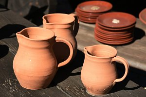 plates and jugs of pottery clay