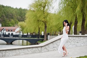 Young brunette elegant woman at whit