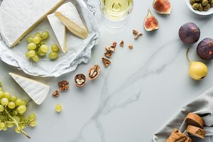 flat lay with cheese, wine and fruit