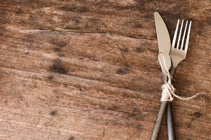 old fork and knife tied with a rope