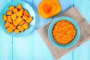 Pumpkin puree in a blue plate on a w