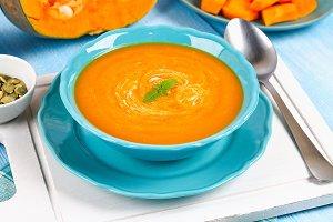 Pumpkin soup puree in a blue plate o