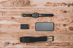 top view of smartphone, belt, lighte