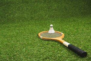 wooden badminton racket and shuttlec