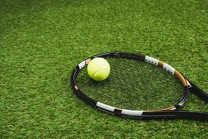 close up view of tennis racket and b
