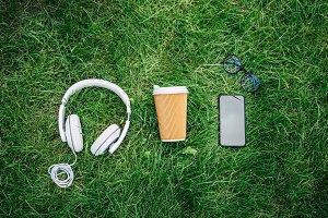 Top view of headphones, smartphone,