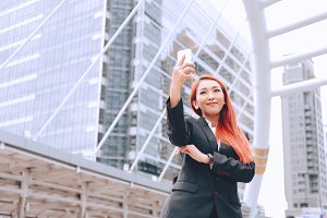 Young Asian business woman smiling a