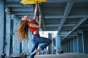 Ballerina dancing with umbrella.