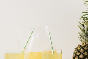 glasses with straws and glass jug wi