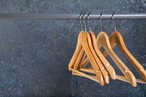 Wood empty hangers on rack with