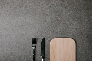 top view of wooden board with fork a
