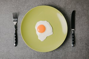 top view of tasty fried egg on plate