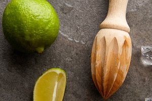 top view of wooden squeezer, limes a