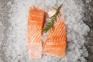 slices of red fish with rosemary bra