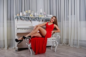 Fashionable gorgeous woman at red lo