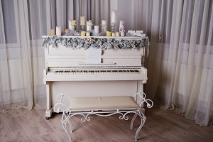 Old piano with new year decorations,