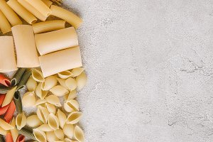 top view of different raw pasta spil
