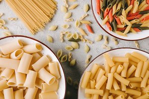 top view of different raw pasta in b