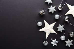 Silver christmas deco baubles on bla