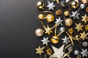 Golden silver christmas deco on blac