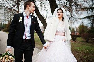 Newlyweds walking, enjoying each oth