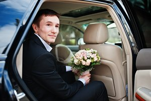 Portrait of a handsome groom sitting