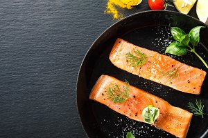 Raw salmon fish on vintage pan