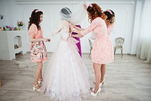 Helpful bridesmaids and mother helpi
