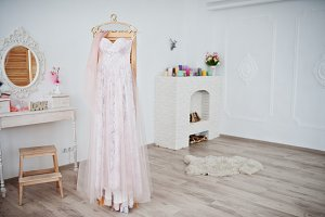 Beautiful wedding dress hanging on t