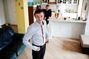 Portrait of a handsome groom dressin