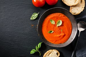 Creamy tomato soup served in bowl
