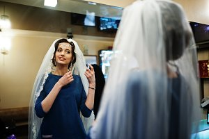 Portrait of a gorgeous bride putting