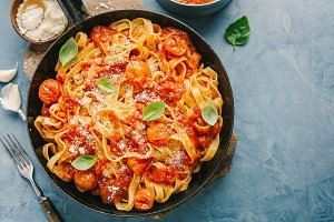 Tomato sauce spaghetti pasta on pan