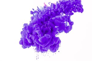 abstract splash with purple paint in